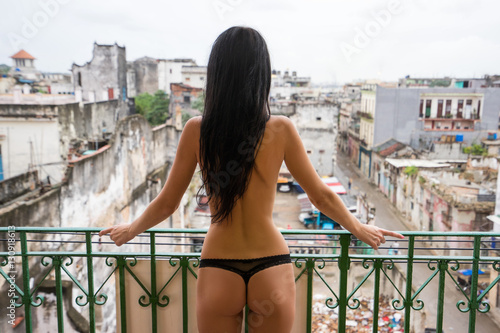Poster Havana Young naked slender tall woman with long black hair stands alone