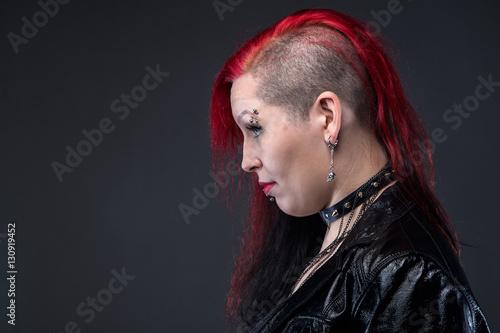 Fotografie, Obraz  Informal woman in leather jacket, profile
