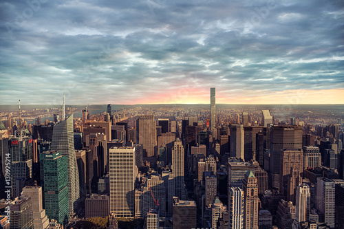 New York city skyline with sunrise in background.