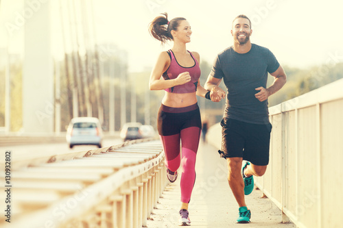 Foto op Canvas Jogging Happy Couple Jogging