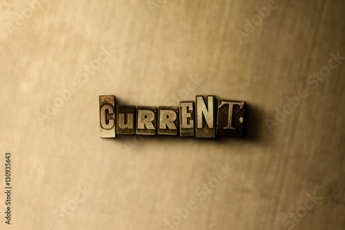 фотография  CURRENT - close-up of grungy vintage typeset word on metal backdrop