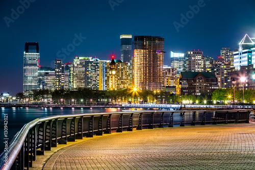 Canvas Prints Night blue Jersey City skyline by night along Hudson river promenade.
