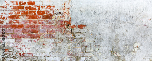 Photo sur Toile Brick wall Vintage brick rough rustic wall with cracked plaster