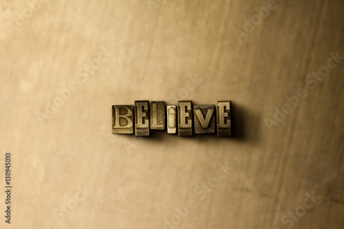 Photo  BELIEVE - close-up of grungy vintage typeset word on metal backdrop