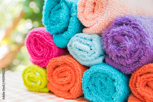 Valokuva  Closeup Multicolor towels with nature blur background