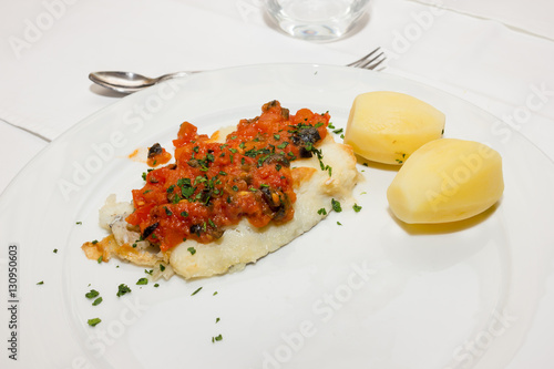 Photo  John Dory with potatoes and tomato