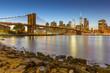 Manhattan skyline at sunset with Brooklyn Bridge, New York City