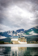 Cruise Ship At Port In Juneau, Alaska On A Cloudy Summer Day