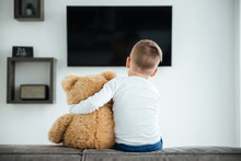 Back View Image Of Cute Little Boy Watching TV