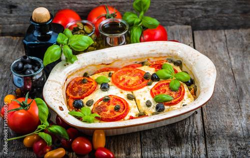 Feta baked with tomatoes  Greek food of mediterranean diet