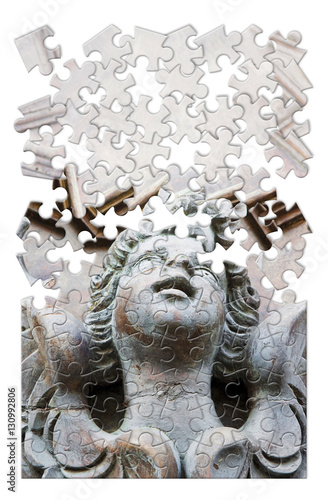 Fototapeta  Sculpture of an angel on a wooden door - concept image in puzzle shape
