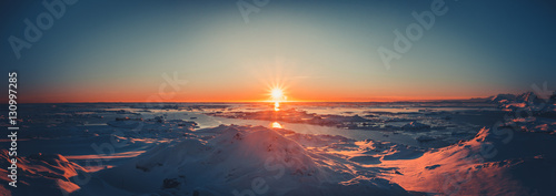 Summer sunset in Antarctica. Beautiful winter background