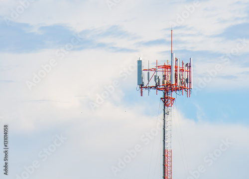 Antenna repeater tower on blue sky, wireless