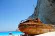 a ship wreck on the beautiful beach at greece