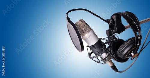 Fotografie, Obraz  Studio condenser microphone and equipment blue isolated
