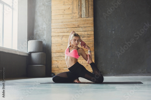 Fototapety, obrazy: Young woman in yoga class, mermaid pose asana
