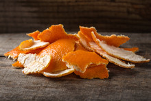 Fresh Orange Peels On Wood