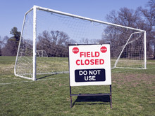 FIELD CLOSED SIGN With Soccer Goal In Background. Horizontal.