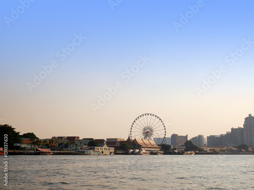 Bangkok Chao Phraya riverside scenery with ferris wheel Poster