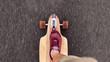 canvas print picture - teenager rollt in seiner freizeit mit longboard über die straße