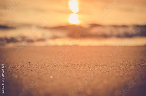 Deurstickers Zalm Blur tropical sunset beach with bokeh sun light wave abstract background.