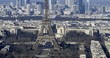 Tilt up arial time lapse view of the Eiffel tower and the financial district of La Defense in Paris