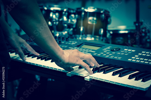 Closeup hands playing the keyboard or piano on brand music instr - 131096275