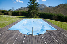 Swimming Pool With Wooden Curb...