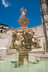 Fototapeta na wymiar sculpture in fountain next to facade landmark of famous gothic catholic cathedral St Mary or Santa Maria, monument from XIII Century, in Burgos city, Castile, Spain Europe