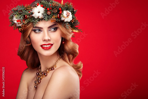 portrait of beautiful young woman with christmas wreath beautiful new year and christmas tree holiday