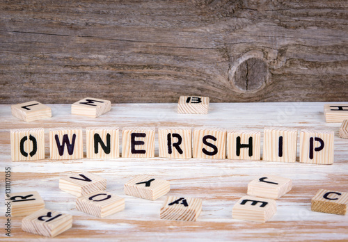 Fotografie, Obraz  Ownership from wooden letters on wooden background