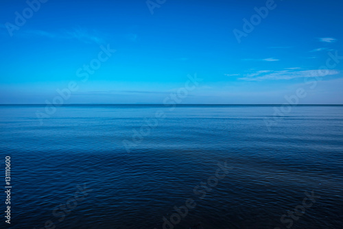 Foto op Aluminium Zee / Oceaan Tranquil dark and deep ocean with blue sky