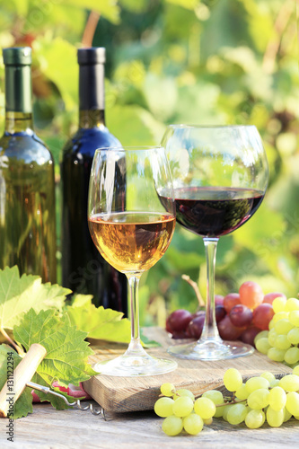 Fototapety, obrazy: Wine in glasses with bunch of grape and cheese on wooden table