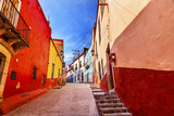 Fototapeta Uliczki - Many Colored Red Yellow Houses Narrow Street Guanajuato Mexico