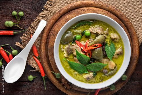 Thai food chicken green curry on dark wooden background. top view
