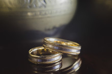 Wedding Rings On A Background Of An Ancient Vase