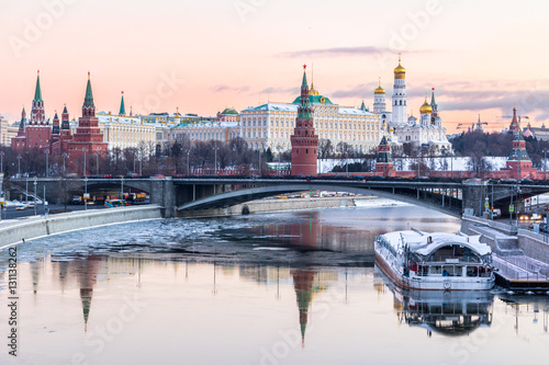 Fotobehang Moskou Moscow Kremlin and Moscow river in winter morning. Pinkish and golden sky with clouds. Russia