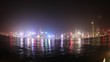 Hong Kong fisheye wide time lapse of skyline with illuminated skyscrapers and red-sail junk boat at night. sea view.