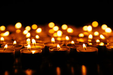 Burning Candles. Many Burning Candles Shining In The Dark. Shallow Depth Of Field.