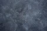 Fototapeta Kamienie - Dark stone or slate wall.