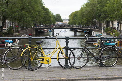 Fototapety, obrazy: Cityscape with bridges, canals and parked bicycles, typical of this city.