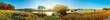 canvas print picture - Panorama einer Landschaft im Herbst mit Pferden auf einer Weide am Fluss
