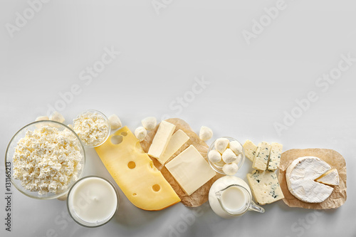 Fotobehang Zuivelproducten Dairy products on white background, top view
