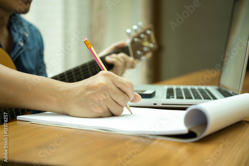 Selected focus on pencil songwriter working on new composition Wallpaper Mural