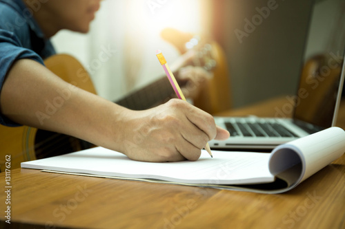 Photo  Selected focus on pencil songwriter working on new composition w