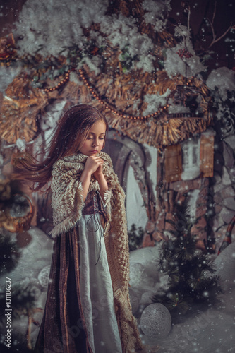 Printed kitchen splashbacks Historical buildings Little girl is wrapped in a beautiful warm shawl, and warming his hands with his breath.Snow, wind develops hair.Shooting in image of Cinderella.Photo high key style.Fashion toning.Creative color.