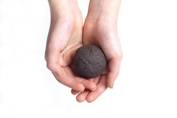 Clayey soil - test ball in hands on white background