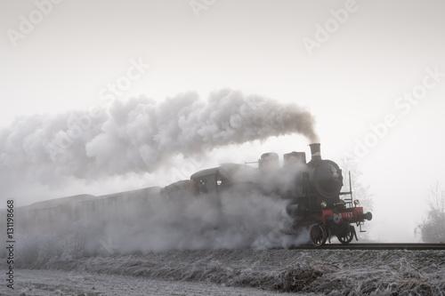 Fotobehang Spoorlijn Steam train running in the fog