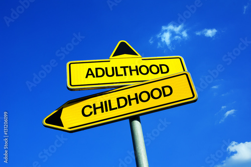 Fényképezés Adulthood vs Childhood - Traffic sign with two options - being adult vs being child