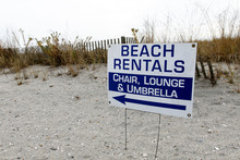 """""""Beach Rentals"""" Sign On A Deserted Beach During Winter."""